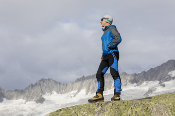 Hiker is thinking about the meaning of life in the Swiss Alps