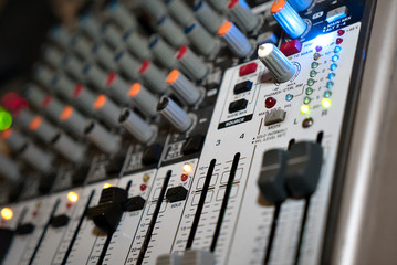Audio mixer for adjusting quality of music at a nightclub. Close-up