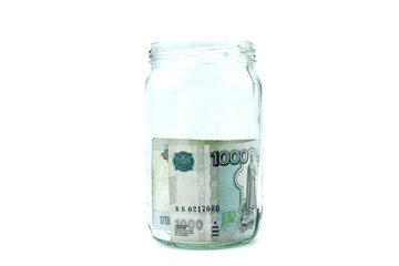Transparent jar with one bill on a white background