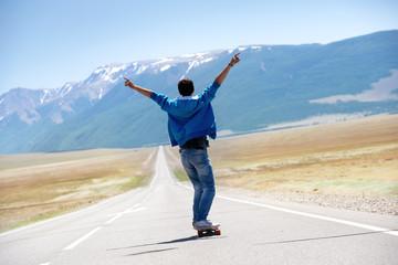 Man skating longboarding straight mountains road
