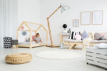 Girl sitting on handmade bed