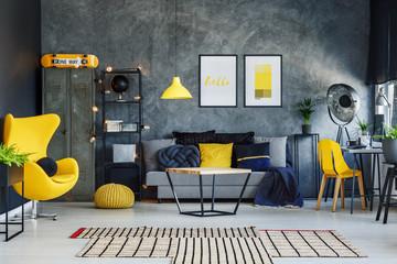 Yellow pillow on grey sofa