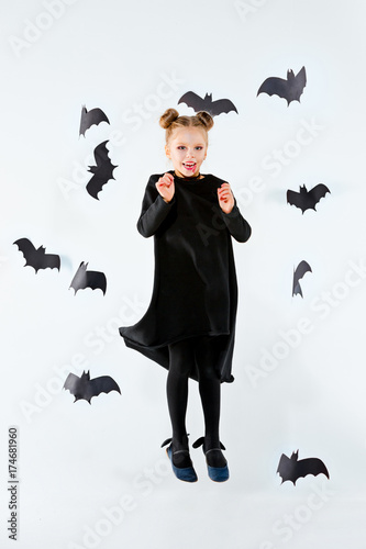 Little Girl Witch In Black Dress Over Magical Accessories Halloween