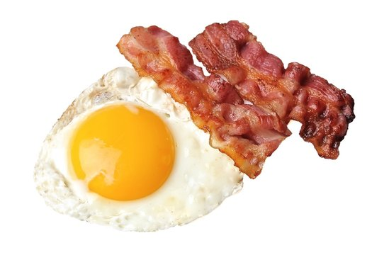 Fried eggs and bacon . Breakfast