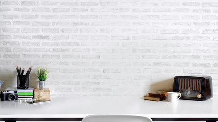 Contemporary desk Workplace with vintage camera, vintage radio, coffee cup and gadget white wood table. Desk space Concept. Desk space background.