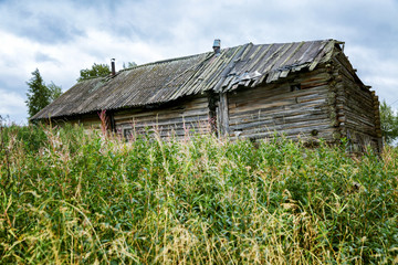old wooden house, in the courtyard of the board, green grass