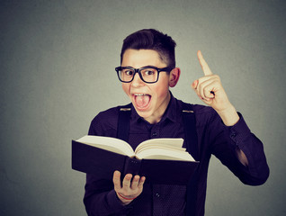 Excited young guy with book has a good idea