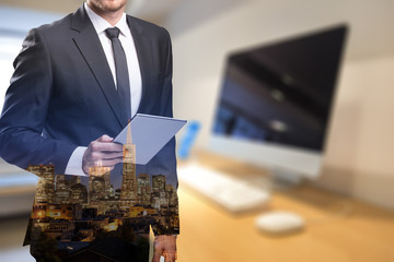 businessman with tablet with blurry office