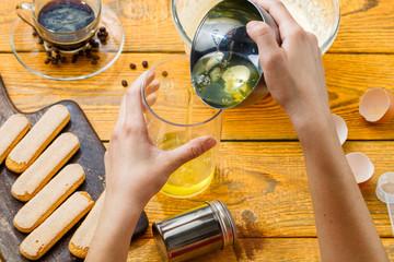 Photo of cooking tiramisu, human hands, cookies