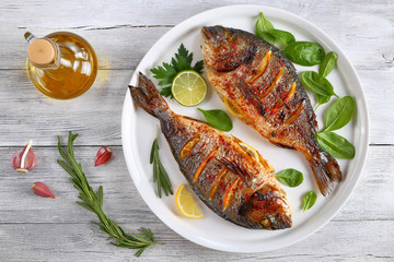 Poster Fish roasted sea bream fish with lemon slices