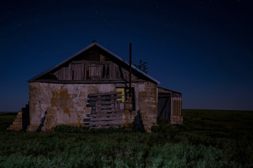 Night landscape with abandoned spooky house