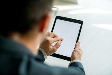 Businessman Typing on digital tablet