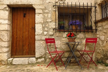 café table and chairs in medieval street in village of Gourdon, Provence, France
