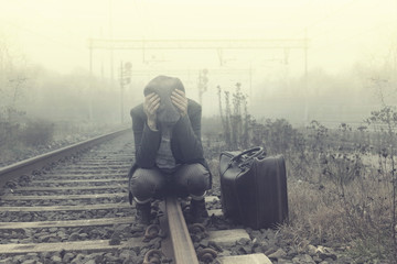 desperate person waits for the train to leave Wall mural