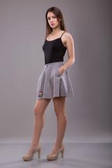 Fashion model dressed in short skirt