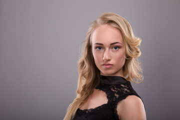 Sensual portrait of beautiful young blond woman with freckles