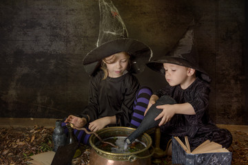 two halloween witches cooking a potion
