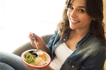Woman eating a healthy bowl of superfoods