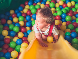 Little baby playing in ball pool