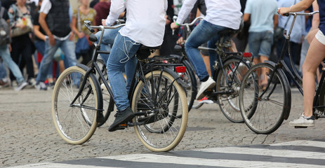 many people riding bicycles in Amsterdam