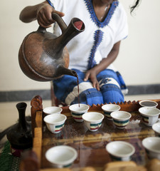 hand pouring Ethiopian coffee during coffee ceremony