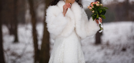 Beautiful bride with a bouquet winter wedding