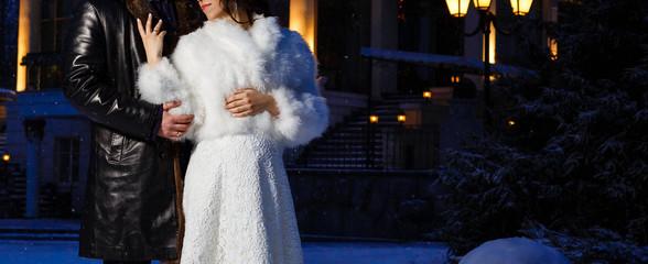 The bride and groom walk with the deer unusual winter wedding