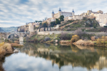 Historic City of Toledo with reflection in Tajo river. Castilla-La Mancha. Spain.