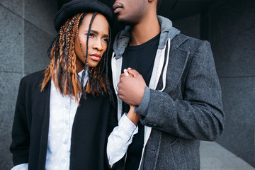 Strong relationship. African American couple. Young fashionable people, stylish man and woman, unrecognizable male, love concept