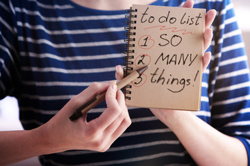 Woman writing to do list