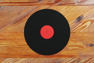 Vinyl record on wooden background