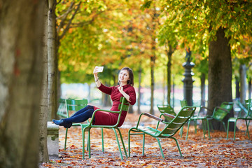 Woman in Paris on a bright fall day