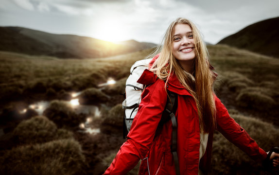 Shot of a young woman looking at the landscape while hiking in the mountains. Girl tourist in mountain. Recreation fitness and healthy lifestyle outdoors in beautiful nature.