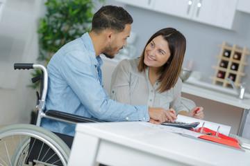 loving girl with her boyfriend in wheelchair