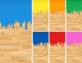 Wooden background with different colors of paints