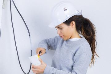 female plumber apprentice