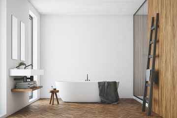 White and wooden bathroom, white tub