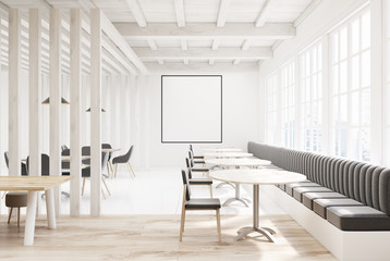 White wooden cafe with gray sofas, poster