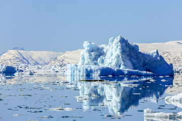 Huge drifting iceberg, view from old harbor in Nuuk city, Greenland