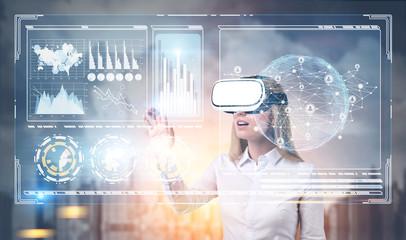 Woman in VR glasses, HUD, graphs, city