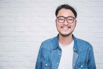 Attractive beautiful positive asian man - close up portrait asian nerdy man