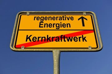 City limits sign with the words regenerative Energien and Kernkraftwerk, German for renewable energy and nuclear power station, symbolic image for the end of nuclear power through the use of renewable energy
