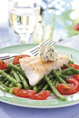 Redfish fillet with beans, tomatoes and herb butter