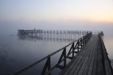 At the end of the jetty of the Federsee lake, shortly before sunrise, Federsee lake near Bad Buchau, district of Biberach, Upper Swabia, Baden-Wuerttemberg, Germany, Europe