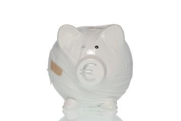 Bandaged piggy bank, symbolic image for the ailing Euro