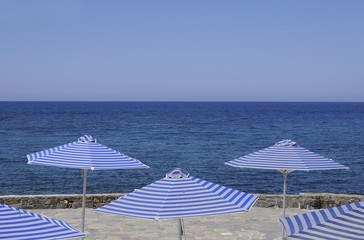 White-blue striped sunloungers and parasols, Crete, Greece, Europe, PublicGround, Europe