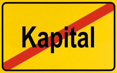 Sign city limits, symbolic image for the end of the dominance of capital