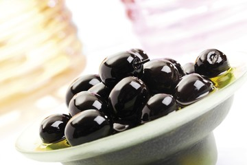 Black olives in a small glass bowl