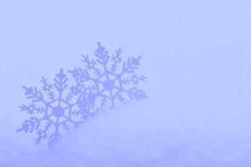 Decorative snowflakes in snow