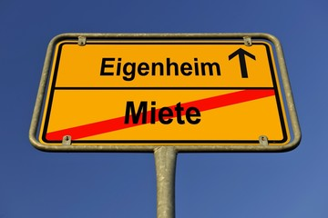 City limit sign, symbolic image for the way from Miete to Eigenheim, German for going from paying rent to owning your own home
